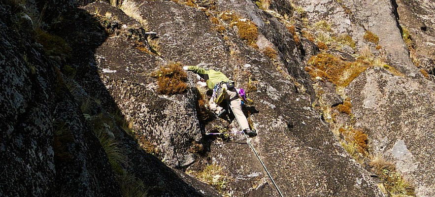 Simon starts the Wainui variant route to the right of Bomb Arete